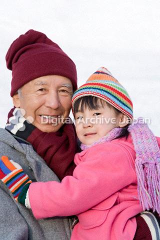 冬の祖父と女の子