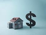 ドル記号と家の模型