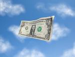 青空に漂うドル紙幣
