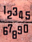 レンガの上の数字