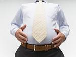 腹部を触るビジネスマン