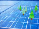 ソーラーパネルに木のミニチュア