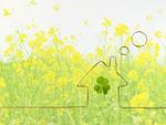菜の花畑とエコ住宅のイメージ
