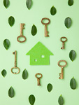 葉と鍵に囲まれたエコ住宅