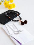 数珠と香典袋(喪イメージ)