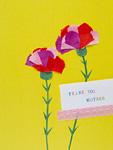 母の日のメッセージカードとカーネーション