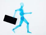 スマートフォンを持つ人体定規