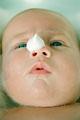 タイトル:Baby with soap on its nose