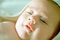 タイトル:Baby wrapped up in a bath towel
