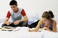 タイトル:Teenage boy and girl doing homework