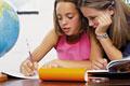 タイトル:Teenage girl doing homework