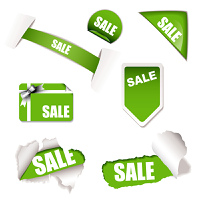 Green sale tag concept with torn paper and gift tag