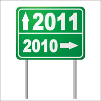 New year road sign for 2011 with arrow and metals post