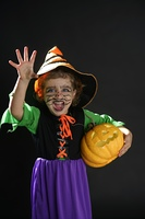 Toddler beautiful witch girl wearing halloween costume and make up