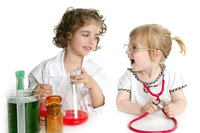 Two girls pretending to be doctor in the laboratory