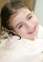 beautiful smiling girl with white towel in bathroom