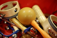 mixed percussion toy instruments on red