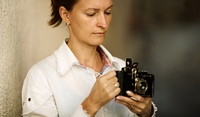 Woman with camera, focus point on eye