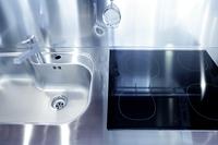 Kitchen silver sink and vitroceramic stove hob modern decoration