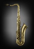 single tenor saxophone on dark wall background
