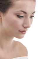 Young womans face with subtle make up and eye lash extensions