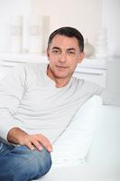Closeup of handsome man relaxing in sofa