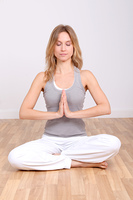 Blond woman doing yoga exercises