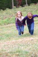 Kids having fun running in park