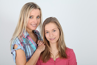 Portrait of smiling blond mother and daughter