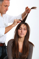 Hairdresser looking for woman's new haircut