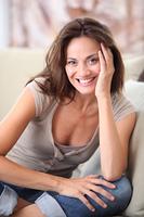 Closeup of beautiful woman relaxing at home