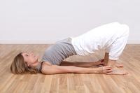 Blond woman doing yoga exercises
