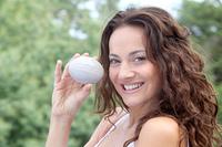 Closeup of beautiful woman holding stone