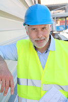 Portrait of senior worker with security helmet