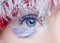 christmas concept blue eye makeup winter red silver macro closeup