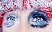 asymmetrical christmas concept eye makeup winter red silver macro closeup