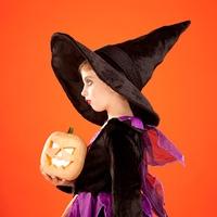 Halloween kid girl costume on orange background