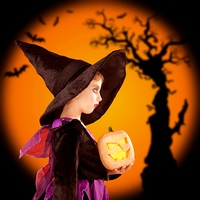 Halloween children girl holding pumpkin Jack o Lantern