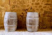 barrels of wine built in oak wood from Spain on stone masonry wall