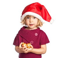 Happy girl in Santa hat holding Christmas decorations in hand isolated on white background