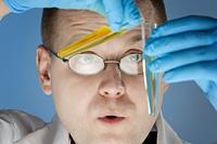 close up portrait of chemist,  focus on the man