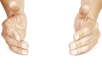 two hands in close-up isolated on white background, selective focus on nearest part