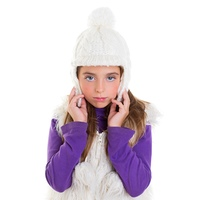 blue eyes child kid girl with white winter cap fur and purple