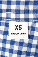 An extra small label on a shirt