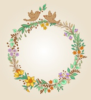Decorative wreath of flowers, leaves and birds