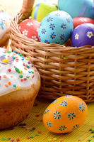 Easter decorations - eggs, cake and basket on the tabletop