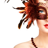 Beautiful young woman in brown mysterious venetian mask. Fashion photo