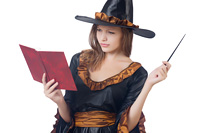 Witch with wand and book isolated on white