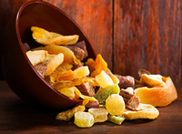 mix of dried fruits on wooden table