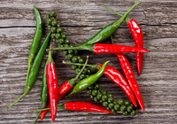 red and green chili pepper on wooden table
